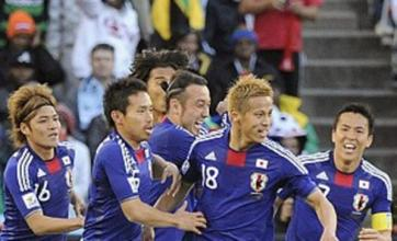 Japan book last-16 spot after free-kicks down Denmark