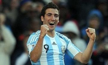 Argentina survive Mexico test to make last eight