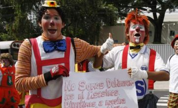 Clowns protest against clown-impersonating armed robbers