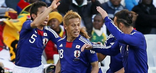 Japan's Keisuke Honda (centre) celebrates his goal against Cameroon
