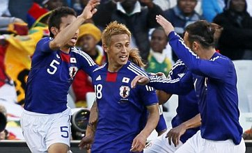 Honda drives Japan to famous win over Cameroon