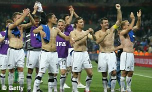 Ryan Nelsen (second right) leads his New Zealand team-mates in celebrating a draw with Italy