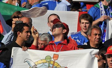 Italian fan spins pizza base in crowd as team fail to rise