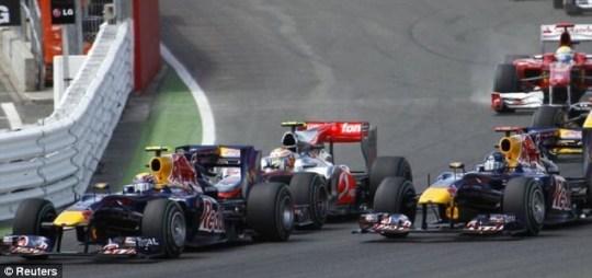 Mark Webber overtakes Sebastian Vettel