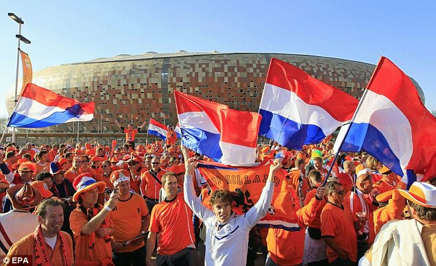 Dutch fans party outside Soccer City Stadium in Johannesburg