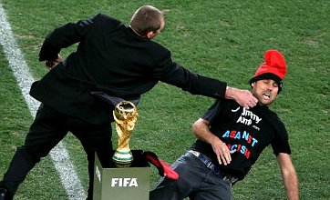 World Cup final pitch invader Jimmy Jump almost gets hold of trophy