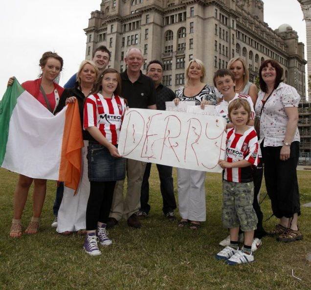 Derry residents wait for the UK City of Culture announcement by Liverpool's Liver Building