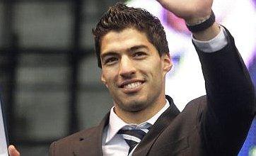 Stekelenburg, Van der Wiel, and Suarez 'set for triple Arsenal transfer'