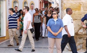 Michelle Obama on holiday, with her 68 agents and bodyguards