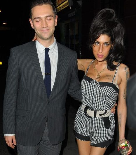 Amy Winehouse and Reg Travis in show of unity