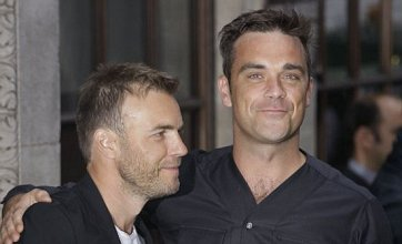 Robbie Williams saddles up with Gary Barlow for Take That cowboy video but he's…Not Brokeback for good