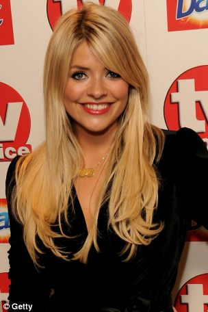 Holly Willoughby smiled her way into the TV Choice Awards last night