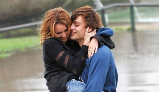 Miley Cyrus looks cosy with co-star Douglas Booth on the set of LOL: Laughing Out Loud in Paris (Photo: Xposure)
