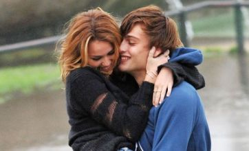 Miley Cyrus cuddles up to hunky co-star as she films LOL: Laughing Out Loud