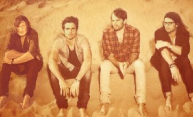 Kings of Leon pose on the cover of their new album Come Around Sundown