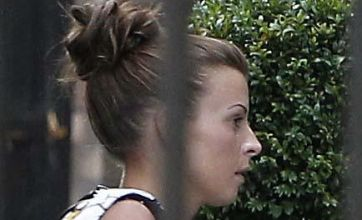 Coleen Rooney takes Kai out shopping while Wayne is kept at a distance