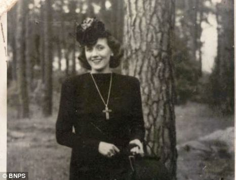 Double life: Margery Booth during her visit to entertain British troops at Stalag IIID Picture: BNPS