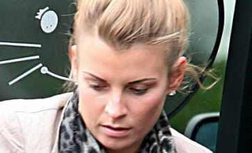 Coleen Rooney sticks by her man as wedding ring stays firmly on