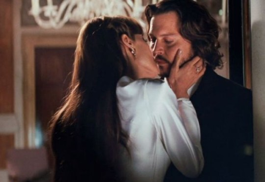 Angelina Jolie gets up close and personal with her The Tourist co-star Johnny Depp
