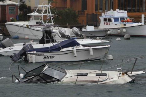 All at sea: This leisure boat was swamped with water at Flatts Inlet, Bermuda, by Hurricane Igor (Pic: AP)