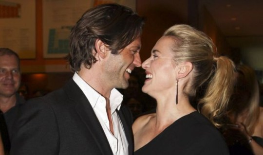 Cosy: Kate Winslet strutted out with new man, model Louis Dowler (Splash)