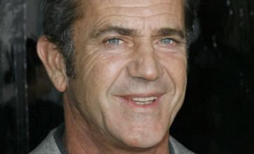 Mel Gibson says sorry for punching Oksana Grigorieva