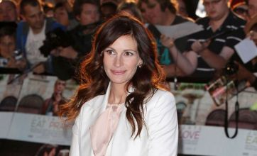Julia Roberts covers up for Eat Pray Love premiere