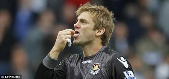 Robert Green licks the tip of his imaginary pen after helping West Ham beat Tottenham