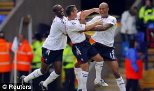 Zat Knight celebrates with his Bolton team-mates after taking the lead against Man Utd