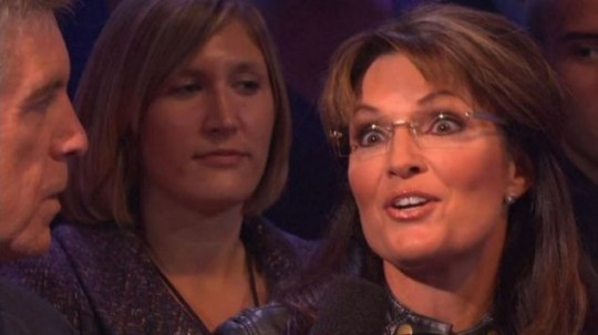 Surprise: A wide-eyed Sarah Palin reacts  to the crowd (Picture: Insight News/ABC)