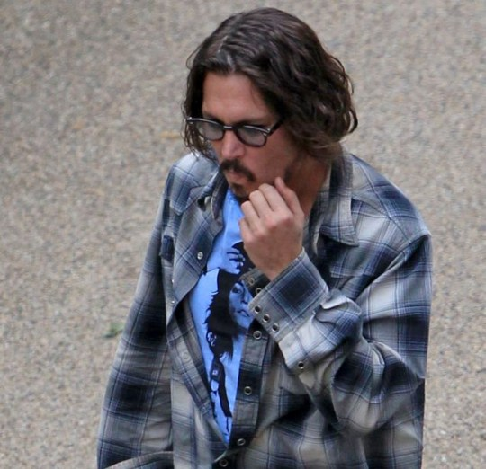 True blue: Johnny Depp heads to the make-up trailer to transform into his role