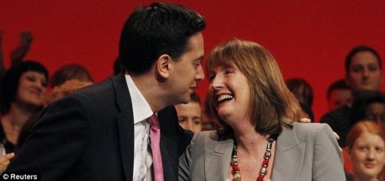 Ed Miliband leans over to kiss deputy leader Harriet Harman