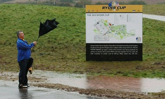 A man struggles with his umbrella at the 2010 Ryder Cup at Celtic Manor (Getty)