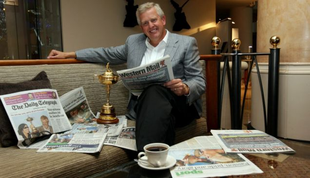 The morning after: Colin Montgomerie relaxes with the Ryder Cup (Picture: Getty)