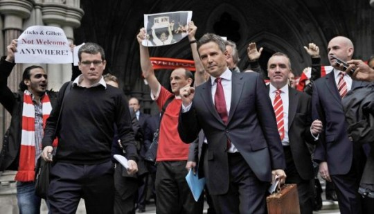Liverpool Football Club Chief Executive Christian Purslow (third right) departs the High Court in London (EPA)