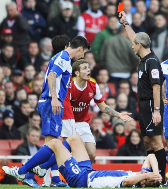 Jack the bad: Wilshere protests his innocence after his challenge on 6ft 8in Nikola Zigic (Picture: Action Images)