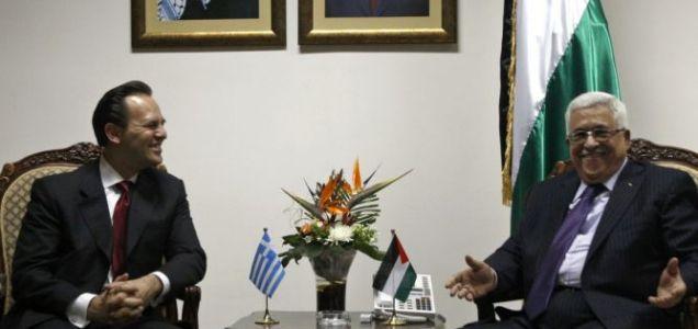 Greek foreign minister Dimitris Droutsas, left, meets Palestinian president Mahmoud Abbas