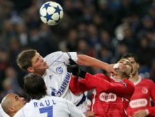 Tel Aviv's striker Itay Shechter (right) vies for the ball with Schalke's Dutch striker Klaas-Jan Huntelaar