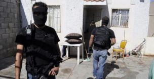 On guard: Police investigations have begun following a multiple shooting at a house party in Ciudad Juarez