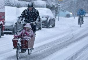Cyclist ride through the snow as more wintry weather is forecast