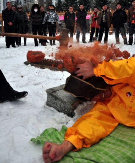 Mir Zhang's head hit with bricks