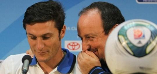 Inter Milan coach Rafael Benitez shares a private joke with Javier Zanetti (AFP/Getty)