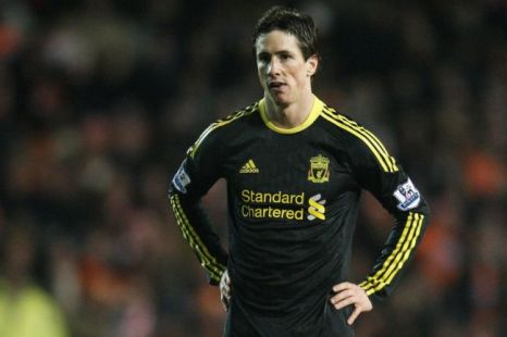 Losing cause: Torres cuts a dejected figure during Liverpool's defeat at Blackpool (Pic: Action)