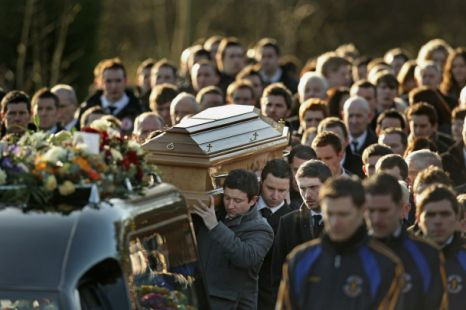 Mourners carry the coffin of Muchaela McAreavey