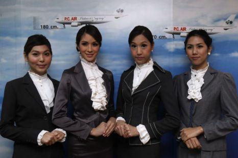 PC Air transsexual flight attendants (L to R): Nathatai Sukkaset, 26, Dissanai Chitpraphachin, 24, Chayathisa Nakmai, 24 and Phuntakarn Sringern, 24, pose for photographers (Picture: Reuters)