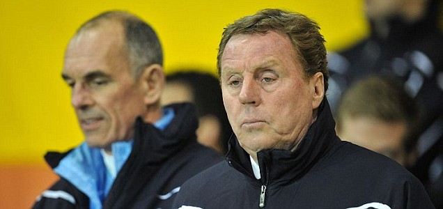 Harry Redknapp looks less than impressed at his side's performance against Blackpool during Tottenham's 3-1 defeat