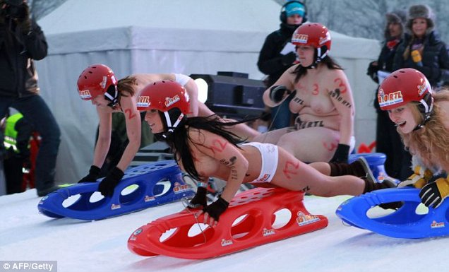 Hotting things up on the ice: Naked sledgers battle it out in the Naked Sledging Contest in Germany