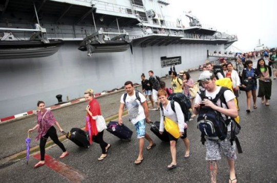 Rescued: Tourists arrive at Sattahip naval base in Thailand's Chonburi province (Picture: AP)