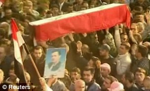 Syrians carry a coffin during a funeral procession for soldiers killed during protests against President Bashar al-Assad in Homs