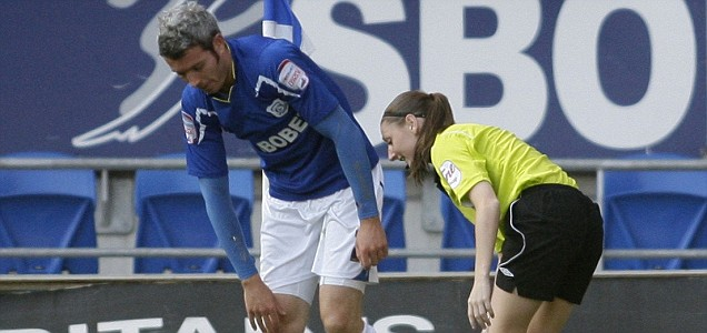 Sian Massey takes a tumble after a collision on the touchline with Cardiff defender Kevin McNaughton